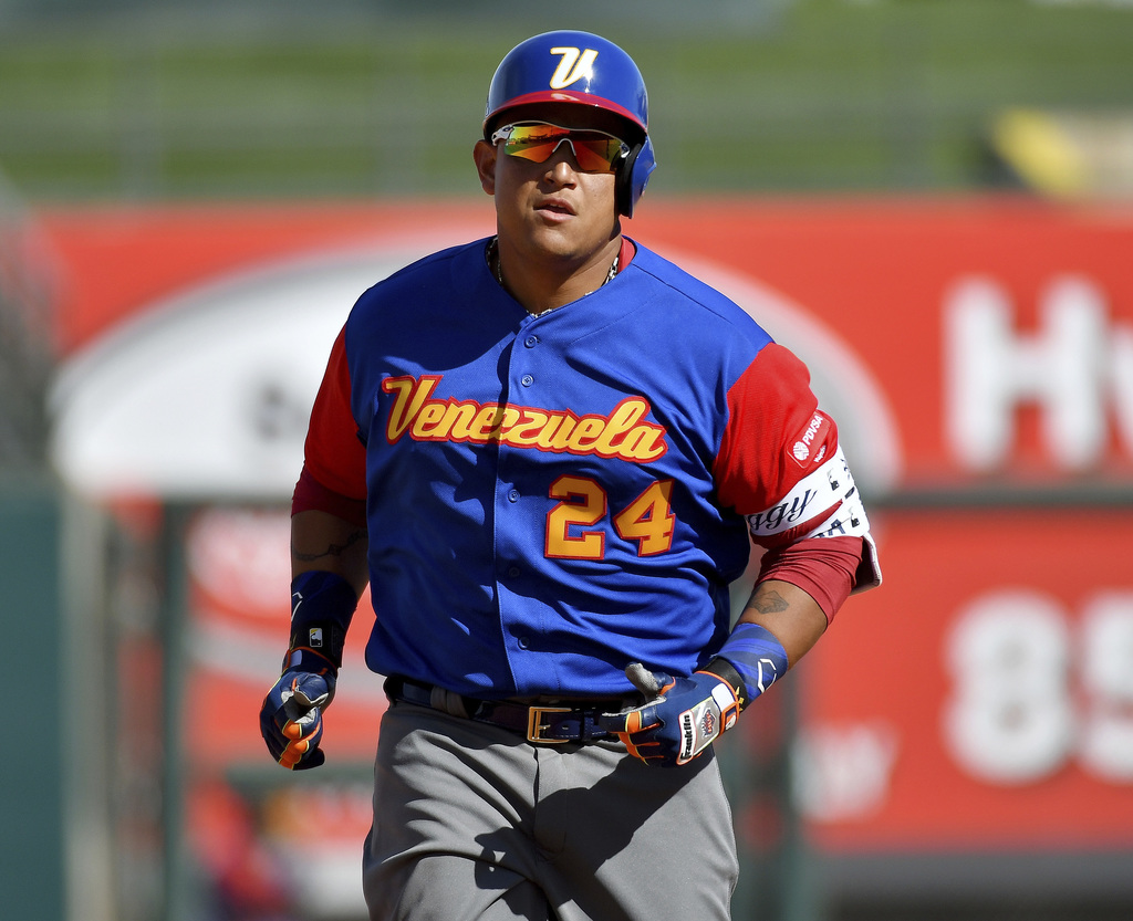 Venezuela's Miguel Cabrera rounds the bases on a solo home run during a spring training baseball game against the Kansas City Royals, W...