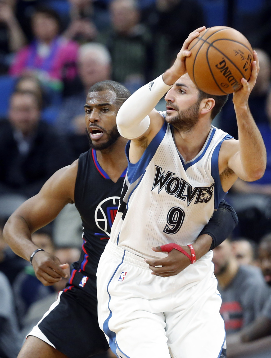 Minnesota Timberwolves' Ricky Rubio, right, of Spain, looks for help as Los Angeles Clippers' Chris Paul grabs him during the second ha...