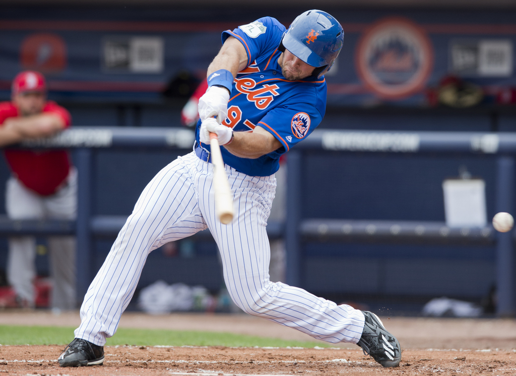 New York Mets designated hitter Tim Tebow swings and misses at a Boston Red Sox pitch during a spring training baseball game Wednesday,...