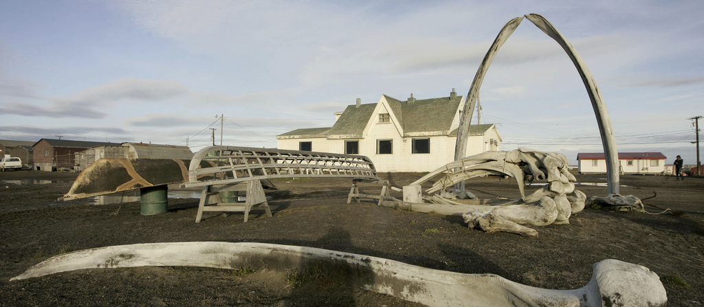FILE - In this Aug. 12, 2005, file photo. a skin boat display sits next to whale bones and an arch made of a whale jaw on the beach at ...