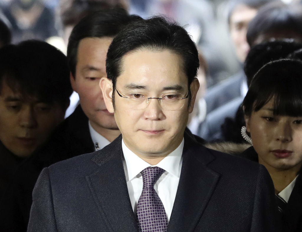 FILE - In this Jan. 18, 2017 file photo, Lee Jae-yong, front, a vice chairman of Samsung Electronics Co. arrives for the hearing at the...