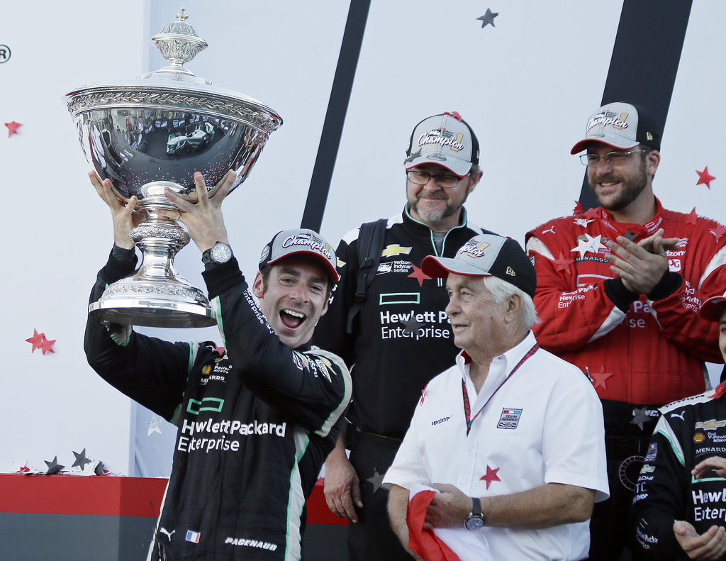 FILE - In this Sept. 18, 2016, file photo, Simon Pagenaud, of France, holds up the Astor Cup after winning the IndyCar auto race and In...