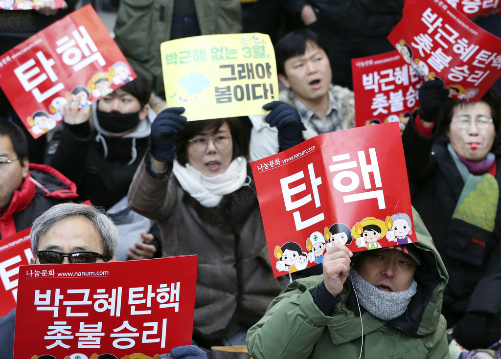 Protesters shout slogans during a rally calling for impeachment of President Park Geun-hye near the Constitutional Court in Seoul, Sout...