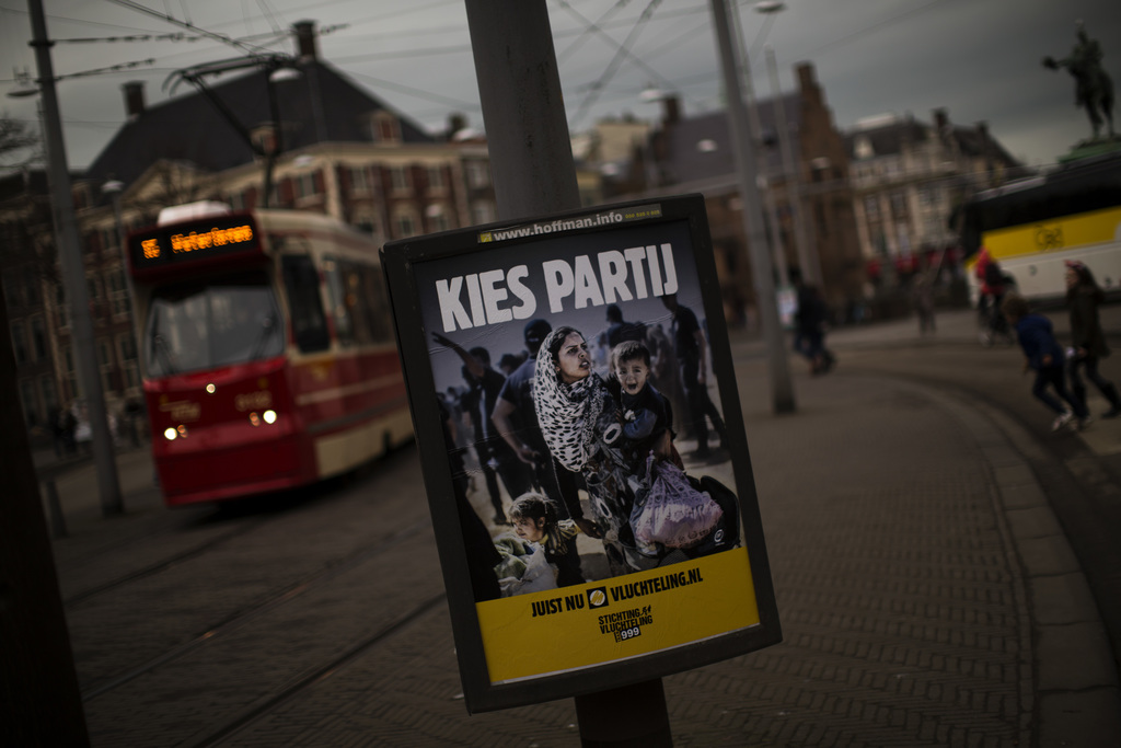 """In this Friday, March 3, 2017 photo, a banner by Stichting Vluchteling (Refugee Foundation of Netherlands), that reads in Dutch """"Choose..."""