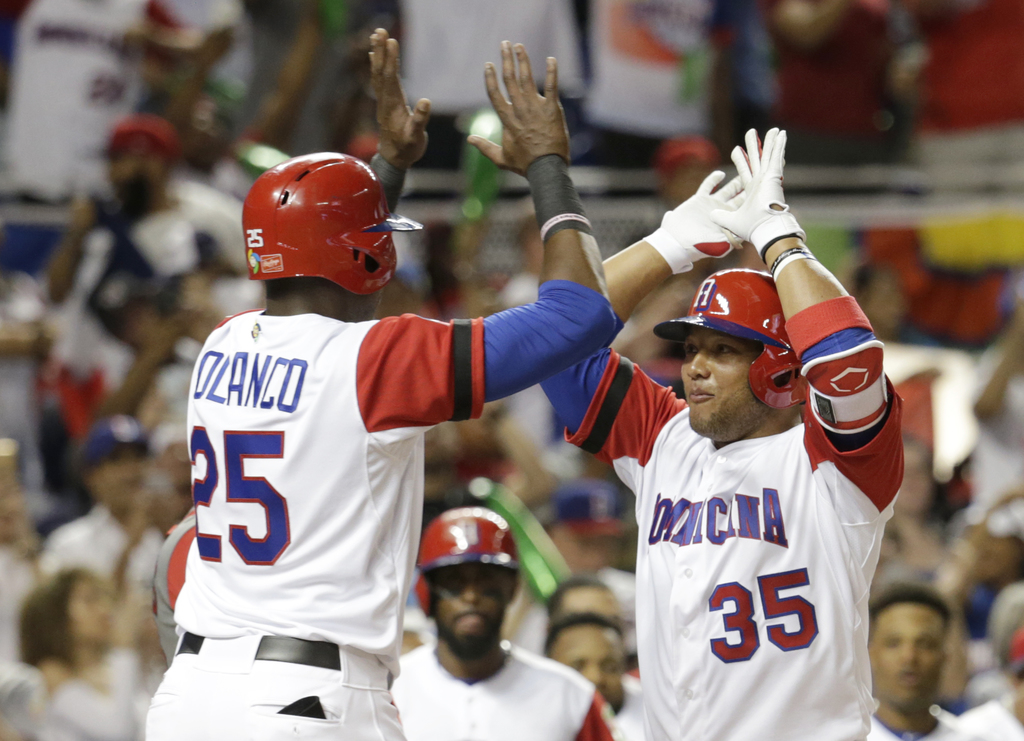 Dominican Republic's Gregory Polanco (25) greets Welington Castillo (35) after they scored on a two-run home run by Castillo during the...