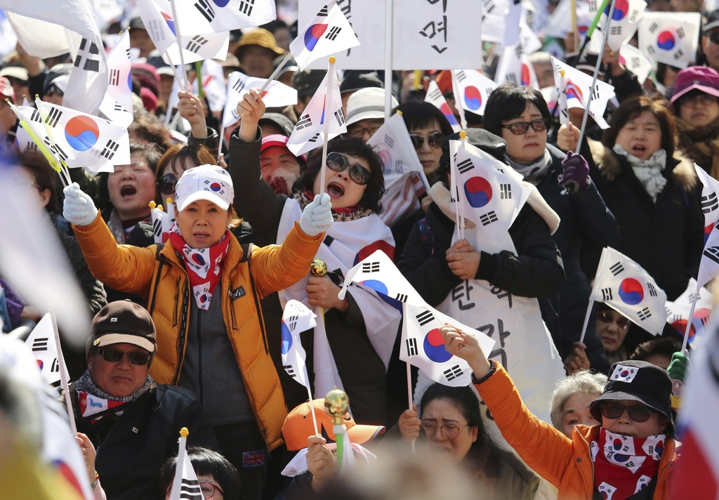 Supporters of South Korean President Park Geun-hye shout during a rally opposing her impeachment near the Constitutional Court in Seoul...