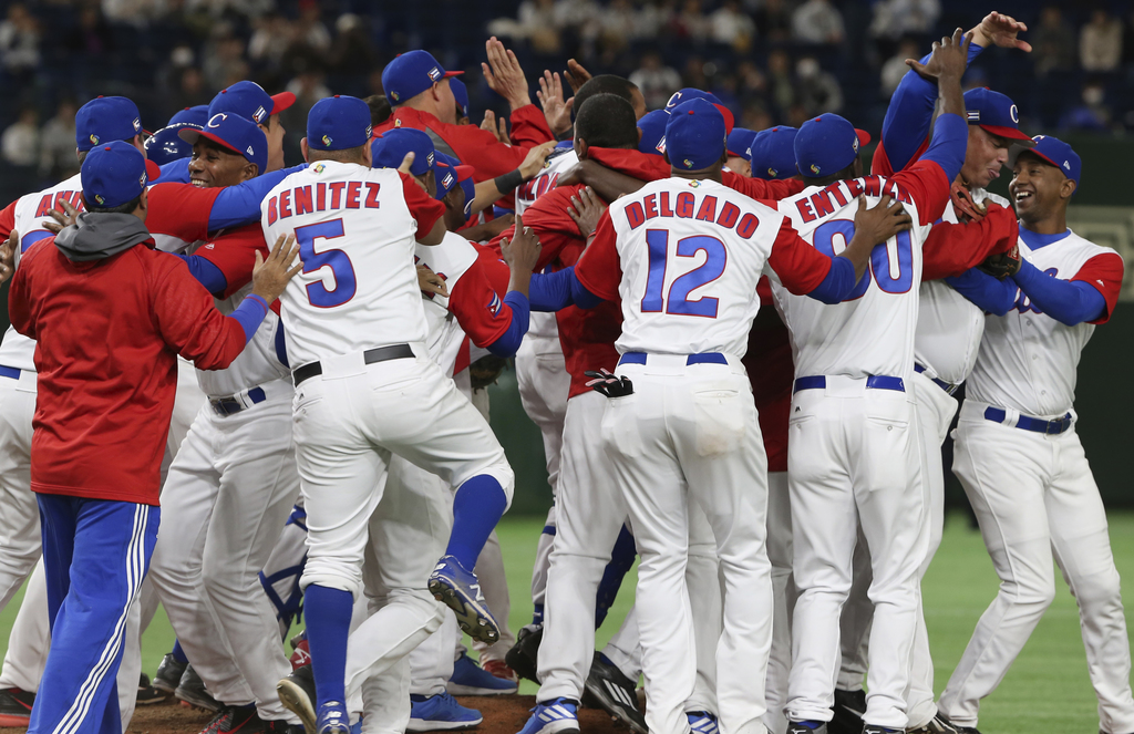 Cuba's players celebrate after their 4-3 win over Australia in their first round game of the World Baseball Classic at Tokyo Dome in To...