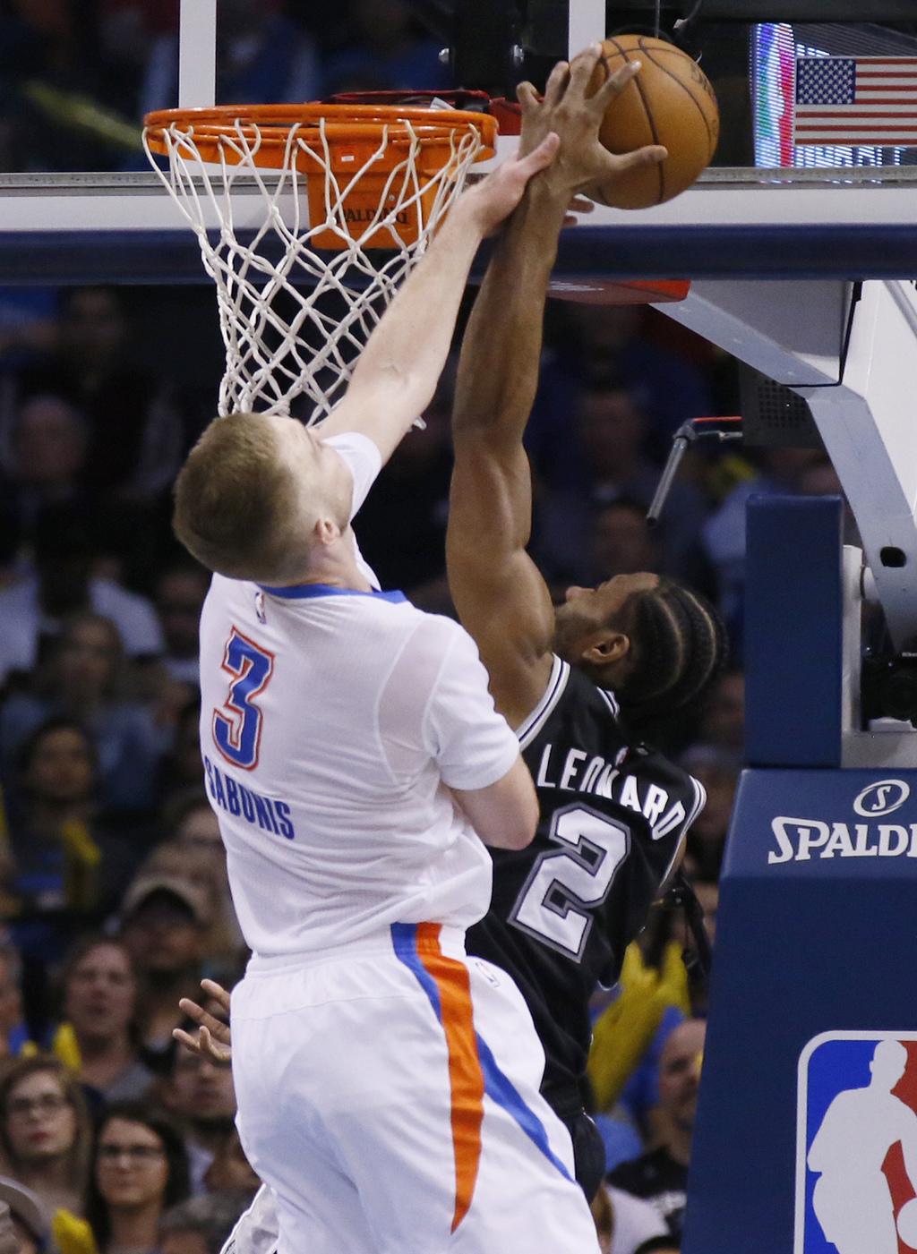San Antonio Spurs forward Kawhi Leonard (2) is fouled by Oklahoma City Thunder forward Domantas Sabonis (3) as he shoots during the sec...
