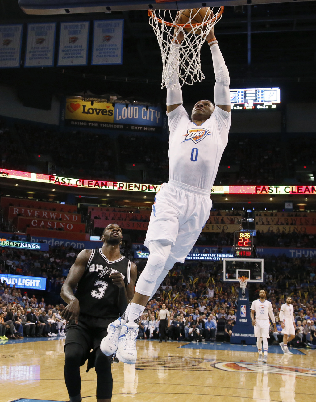Oklahoma City Thunder guard Russell Westbrook (0) dunks in front of San Antonio Spurs center Dewayne Dedmon during the first quarter of...