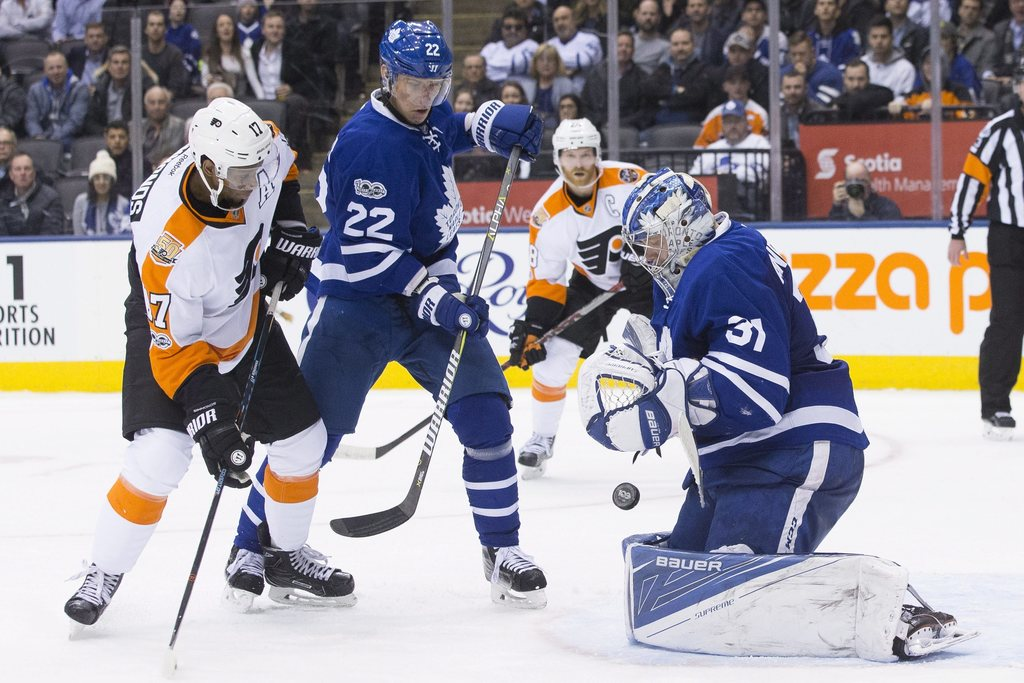 Toronto Maple Leafs goalie Frederik Andersen (31) makes a save in front of Philadelphia Flyers right wing Wayne Simmonds (17) as Leafs'...
