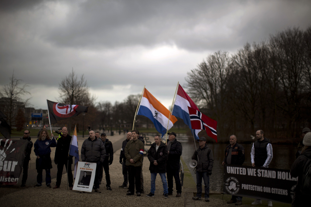 In this Saturday, March 4, 2017 photo, members and supporters of the extreme right wing Nederlandse Volks-Unie (Netherlands People's Un...