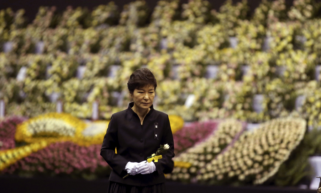 FILE - In this April 29, 2014 file photo, South Korean President Park Geun-hye pays tribute to the victims of the sunken ferry Sewol at...