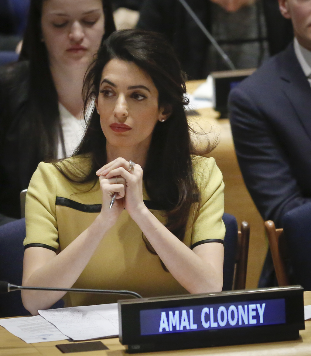 "Human rights lawyer Amal Clooney listens during a United Nations human rights meeting called ""The Fight against Impunity for Atrocities..."