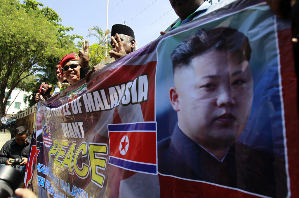 Malaysians protest outside the North Korean Embassy in Kuala Lumpur, Malaysia Friday, March 10, 2017. They were protesting the rising t...