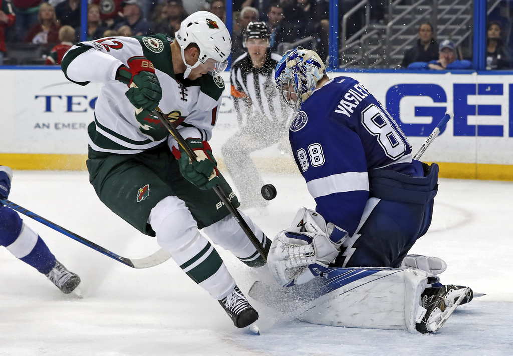 Tampa Bay Lightning goalie Andrei Vasilevskiy, of Russia, makes a save against Minnesota Wild's Eric Staal during the third period of a...
