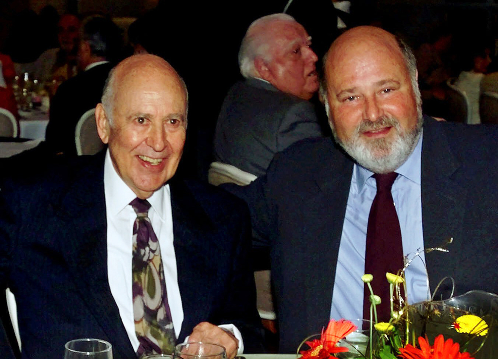 FILE - In this Aug. 18, 2000 file photo, Carl Reiner, left, appears with his son Rob Reiner at a Friars Club of California dinner in hi...