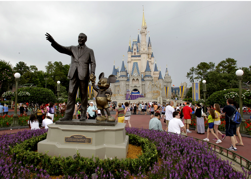 FILE - In this Tuesday, June 5, 2012, file photo, visitors stroll along Main Street at Walt Disney World, in Lake Buena Vista, Fla. On ...