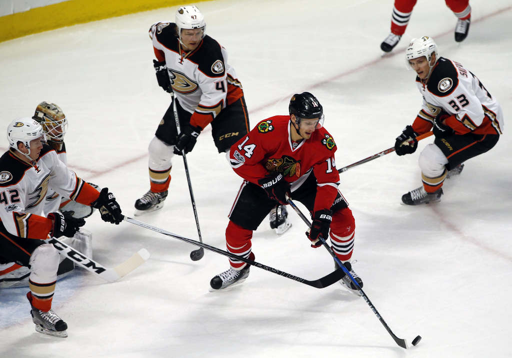 Chicago Blackhawks left wing Richard Panik (14) controls the puck against the Anaheim Ducks during the first period of an NHL hockey ga...