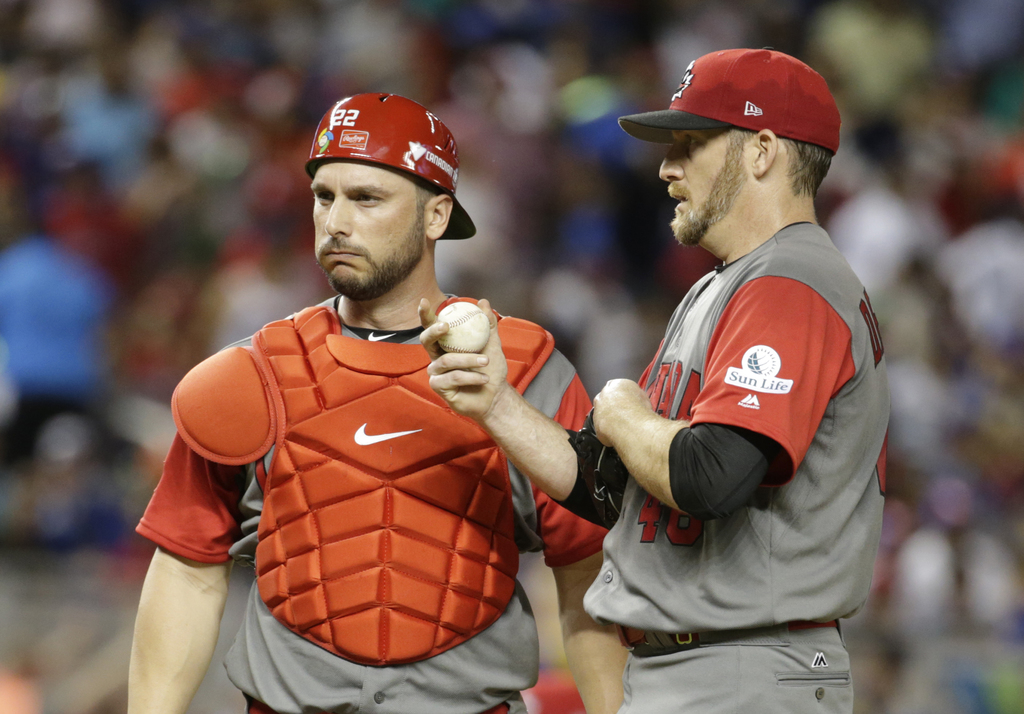 Canada pitcher Ryan Dempster, right, talks with catcher George Kottaras, left, during the second inning in a first-round game of the Wo...