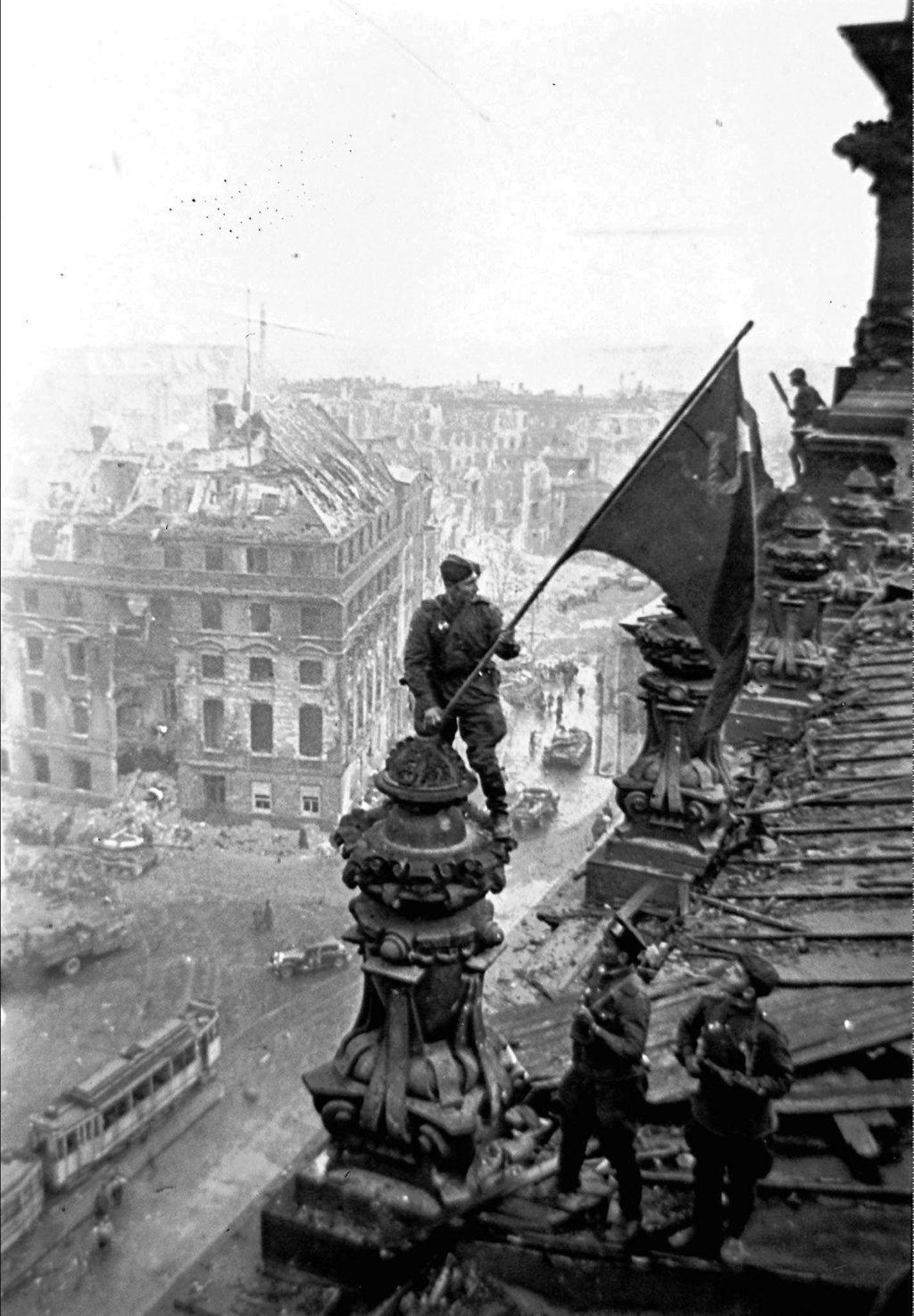 FILE- In this May 2, 1945 file photo, Soviet soldiers hoist the red flag over the Reichstag after the fall of Berlin, which is one of t...