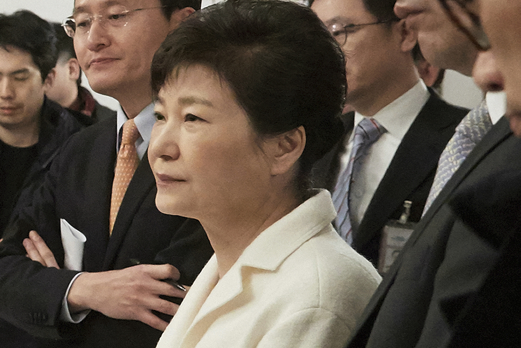 FILE - In this Jan. 1, 2017, file photo provided by the South Korean Presidential House, impeached South Korean President Park Geun-hye...