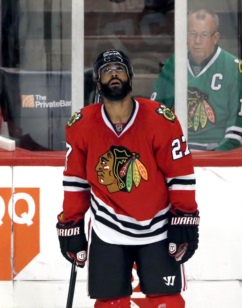 Chicago Blackhawks defenseman Johnny Oduya looks at the scoreboard after Anaheim Ducks right wing Corey Perry scored a goal during the ...