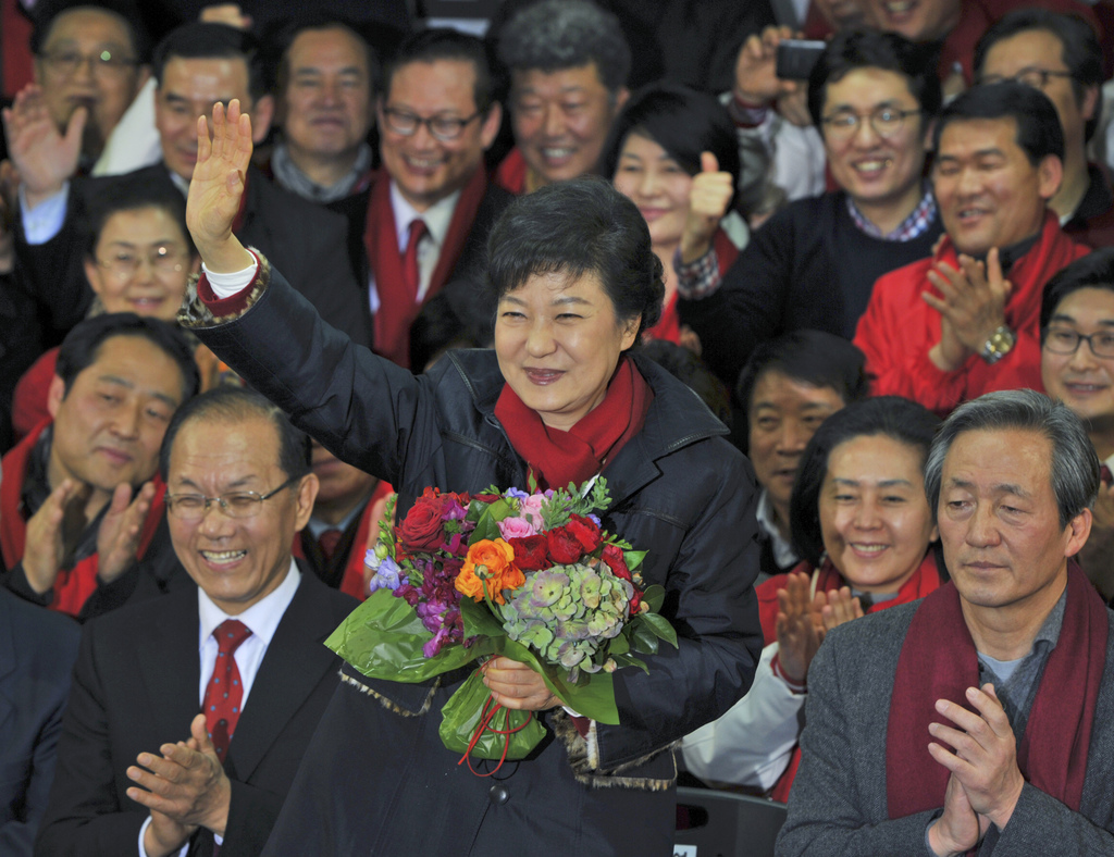 FILE - In this Dec. 19, 2012 file photo, South Korea's presidential candidate Park Geun-Hye, center, of ruling Saenuri Party, waves to ...