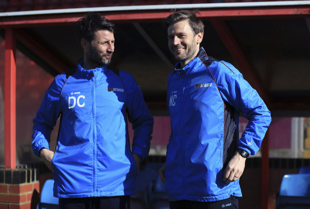 Lincoln City manager Danny Cowley, left, speaks with assistant manager and brother Nicky at Sincil Bank, Lincoln, England, Thursday, Ma...