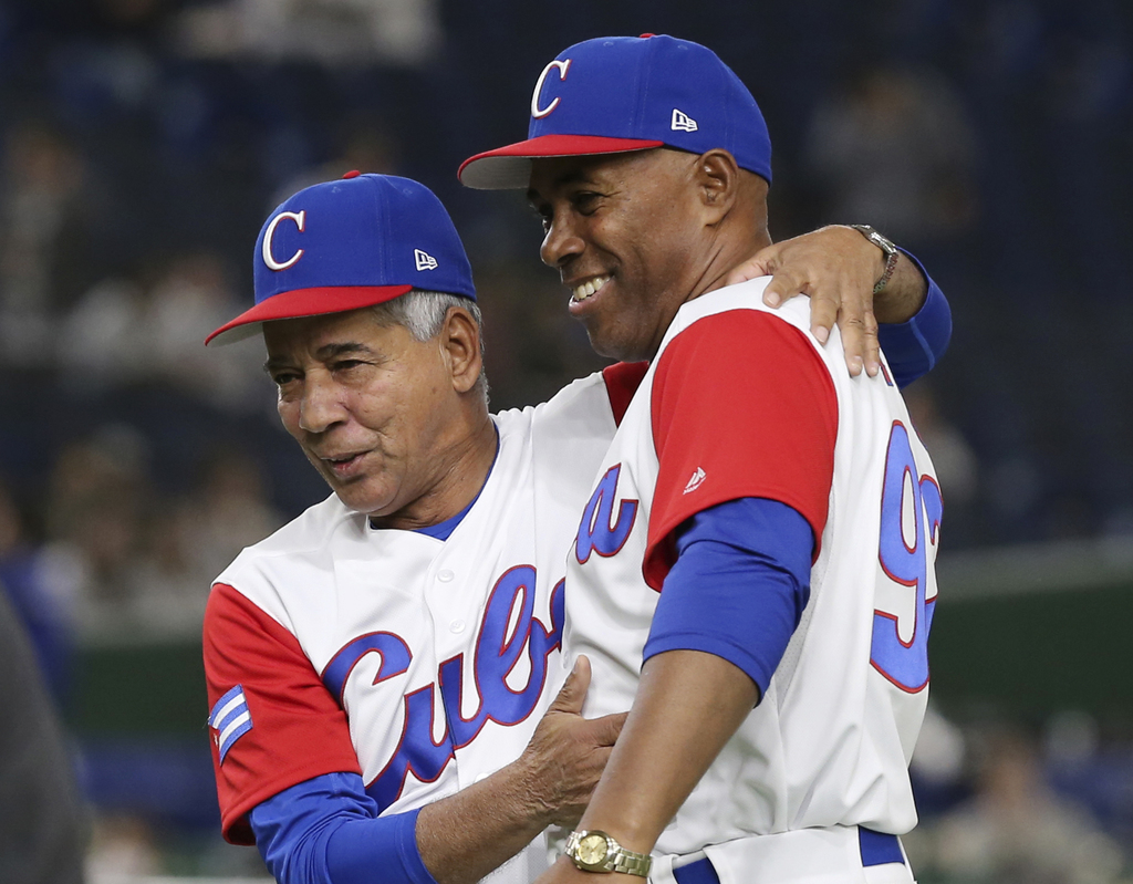 Cuba's manager Carlos Marti, left, celebrates with coach Carlos Louis after their 4-3 win over Australia in their first round game of t...
