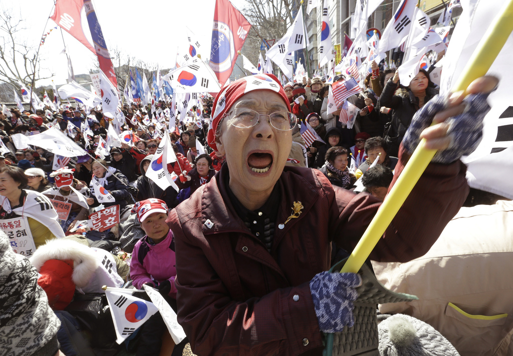 A supporter of South Korean President Park Geun-hye cries during a rally opposing her impeachment near the Constitutional Court in Seou...