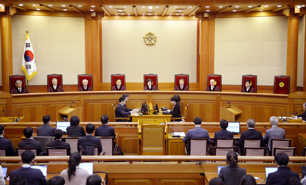 Judges are seated at the start of the ruling of impeached South Korean President Park Geun-hye at South Korea's Constitutional Court in...
