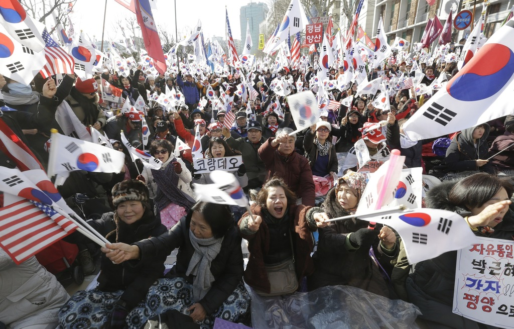 Supporters of South Korean President Park Geun-hye shout slogans during a rally opposing her impeachment near the Constitutional Court ...