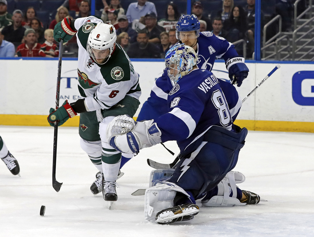 Minnesota Wild's Marco Scandella looks for a rebound in front of Tampa Bay Lightning goalie Andrei Vasilevskiy, of Russia, during the t...
