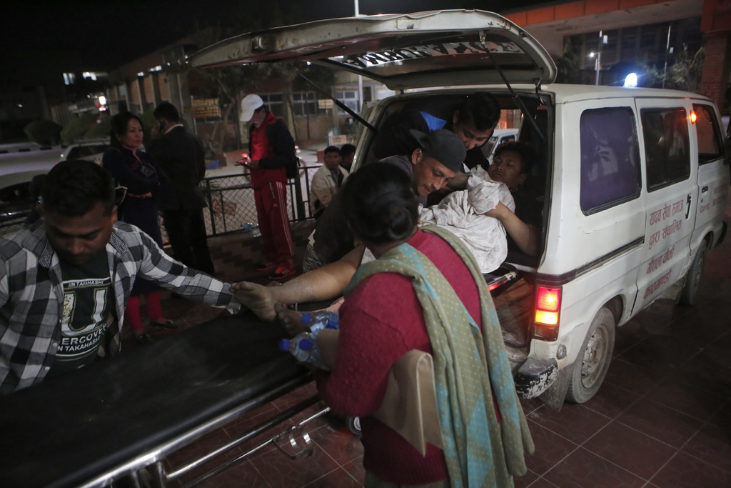 In this March 1, 2017, photo, a patient is brought to the Teaching Hospital in a ambulance in Kathmandu, Nepal. Nepal is woefully short...