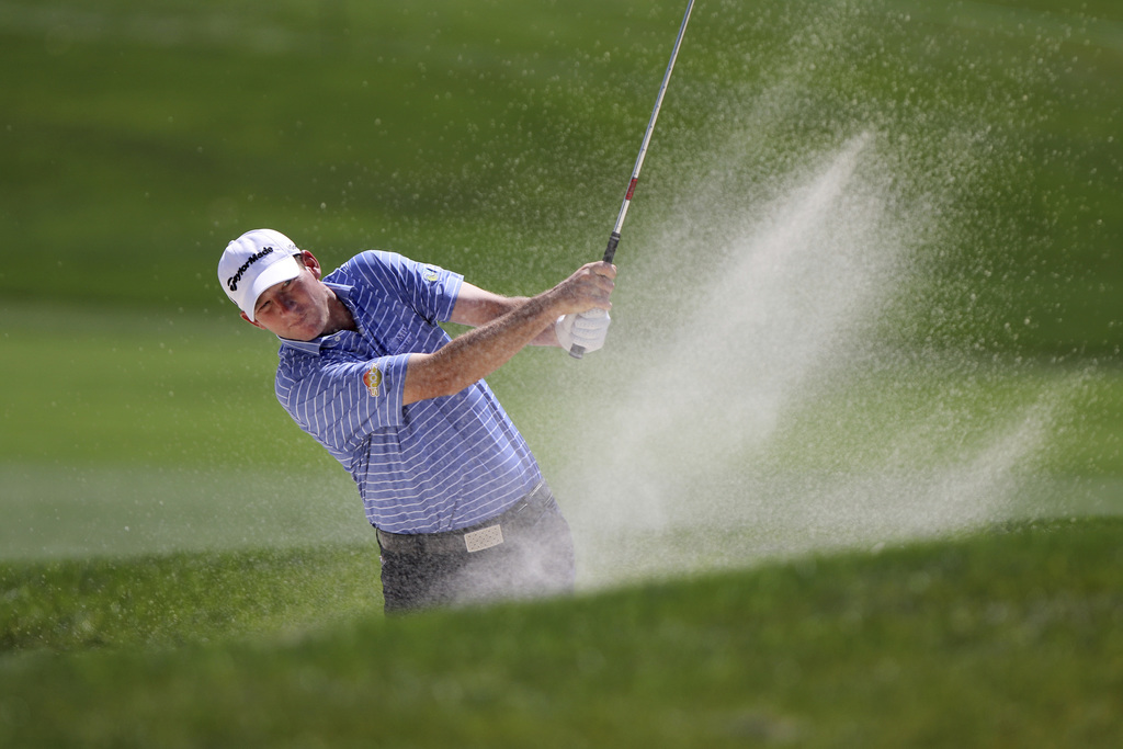 Jim Herman hits from a trap at the ninth hole during the first round of the Valspar Golf Championship in Palm Harbor, Fla., Thursday, M...