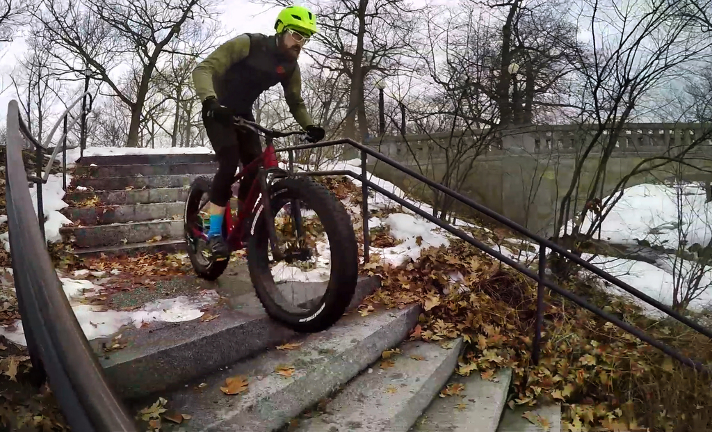 In this Friday, Feb. 24, 2017 photo Range Morton rides down a stairway on his fat tire bike at a park in Portland, Maine. The ginormous...