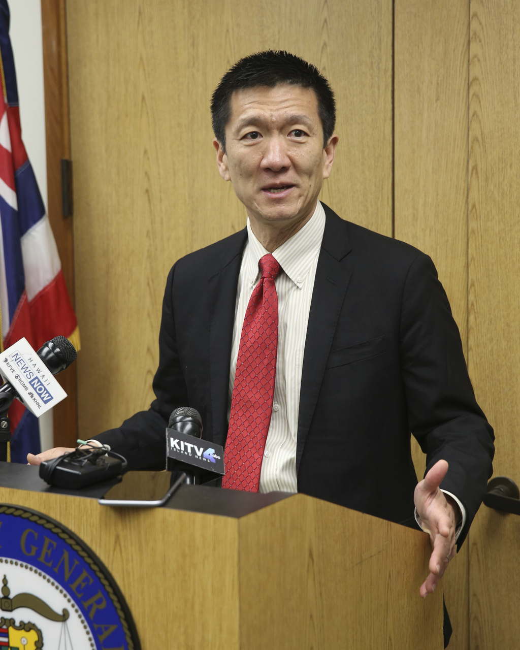 Hawaii Attorney General Douglas Chin speaks at a news conference Thursday, March 9, 2107, in Honolulu. Chin's office filed an amended l...