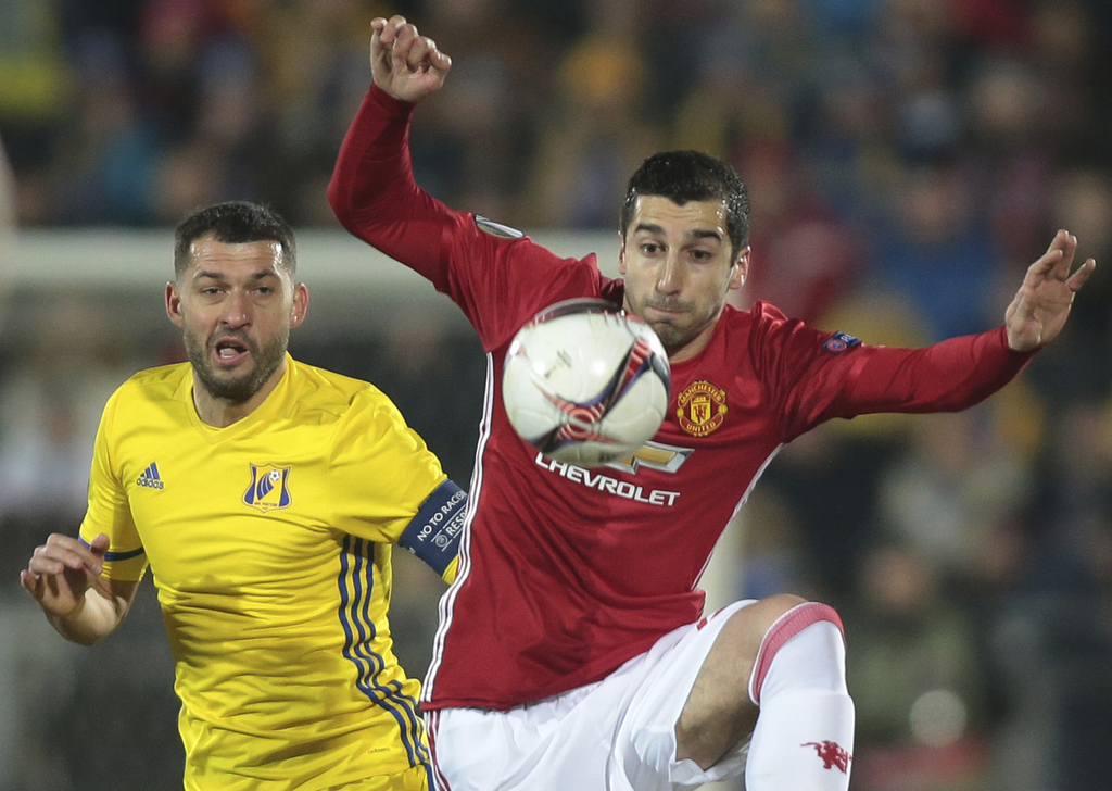 Manchester United's Henrikh Mkhitaryan, right, and Rostov's Aleksandr Gatskan fight for the ball during the Europa League round of 16 f...