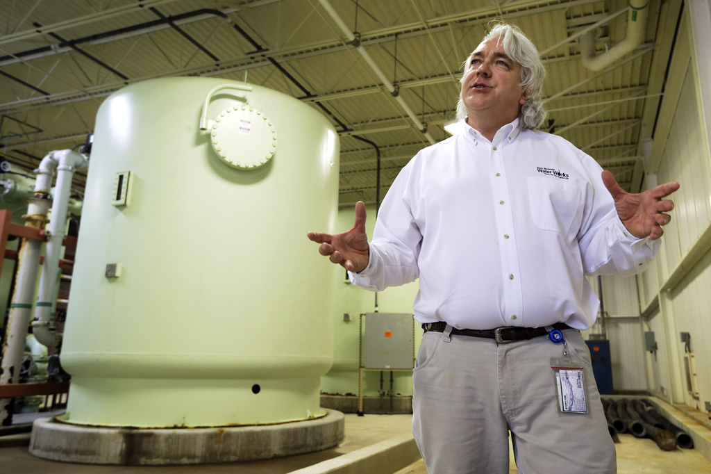 FILE - In this May 16, 2013, file photo, Des Moines Water Works CEO Bill Stowe stands in the Nitrate Removal Facility at the Water Work...