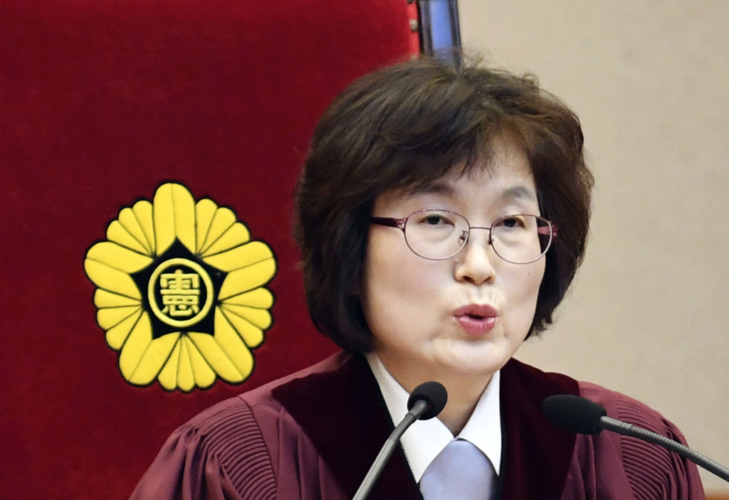 South Korean Constitutional Court's Chief Judge Lee Jung-Mi delivers judgment on the impeachment charge against South Korea President P...