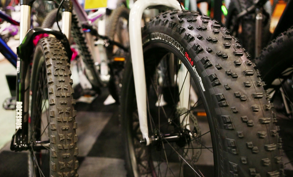 In this Thursday, Feb. 8, 2017 photo a fat tire bike, right, is seen next to a mountain bike at the Gorham Bike and Ski shop in Portlan...