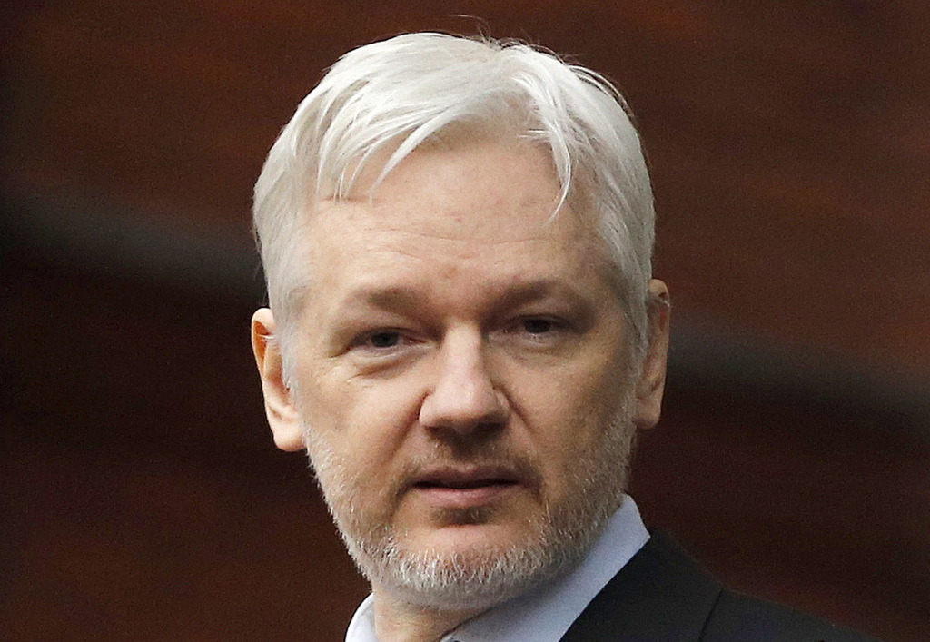 FILE - In this Feb. 5, 2016, file photo, WikiLeaks founder Julian Assange stands on the balcony of the Ecuadorean Embassy in London. As...
