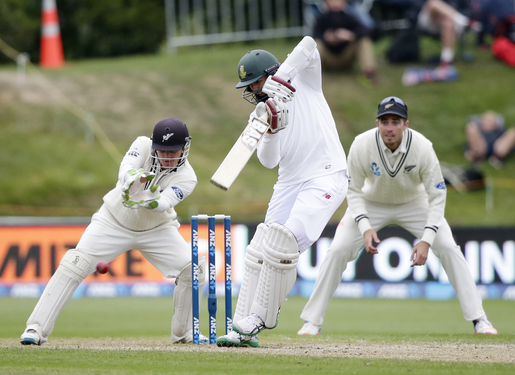 South Africa's Hashim Amla plays a shot as New Zealand's BJ Watling watches during the first cricket test at University Oval, Dunedin, ...