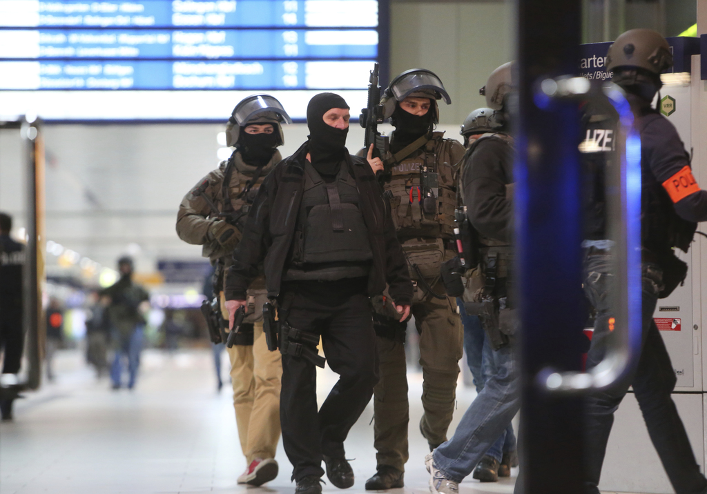Special police forces walk in the main train station in Duesseldorf, western Germany, Thursday, March 9, 2017 after several people have...