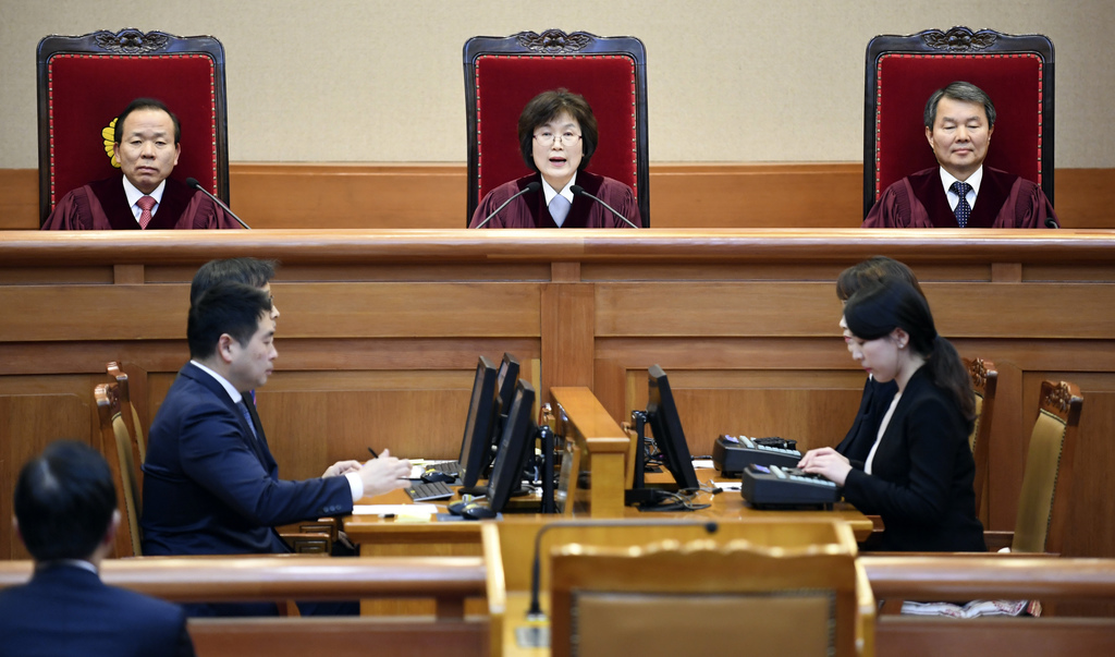 South Korean acting Constitutional Court's Chief Judge Lee Jung-mi, top center, speaks during the final ruling of South Korean Presiden...