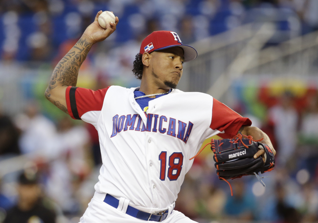 Dominican Republic pitcher Carlos Martinez throws during the first inning in a first-round game of the World Baseball Classic against C...