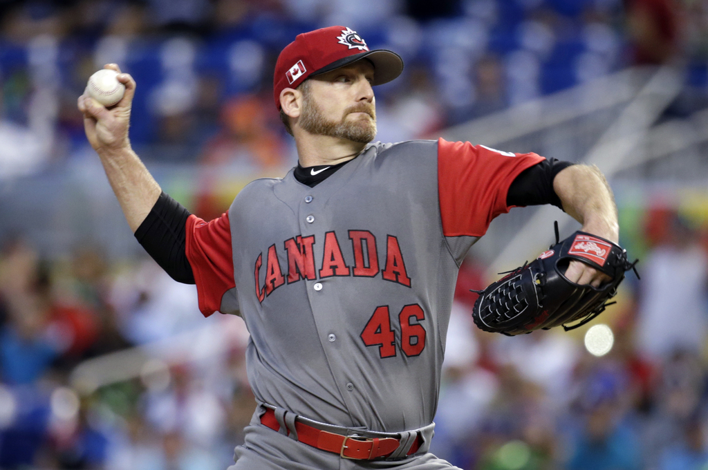 Canada pitcher Ryan Dempster throws during the first inning in a first-round game of the World Baseball Classic against the Dominican R...
