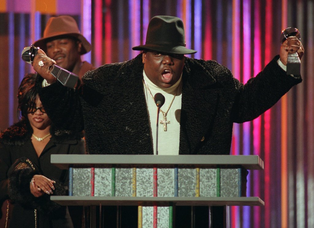 FILE - In this Dec. 6, 1995, file photo, The Notorious B.I.G., who won rap artist and rap single of the year, clutches his awards at th...