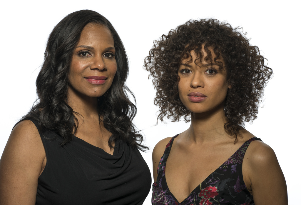 """In this March 5, 2017 photo, Audra McDonald , left, and Gugu Mbatha-Raw appear at a press junket for their film, """"""""Beauty and the Beast..."""