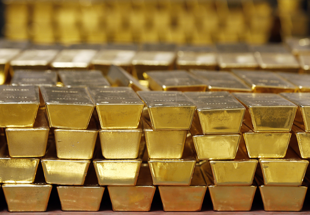 FILE - In this Tuesday, July 22, 2014, file photo, gold bars are stacked in a vault at the U.S. West Point, in West Point, N.Y. On Marc...